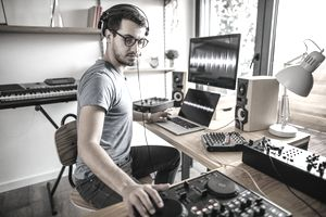 Musician mixing a track at home