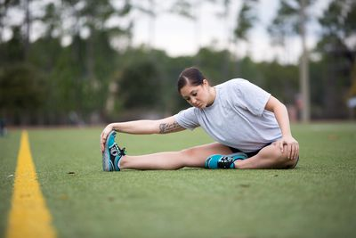 Female Airforce Soldier Stretching on Field