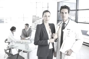 Business professional and doctor in meeting