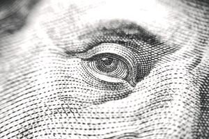 Eye of Benjamin Franklin on currency