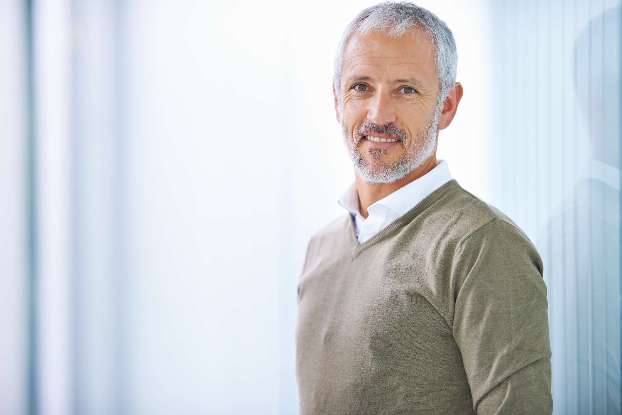 Man in button-down shirt and sweater