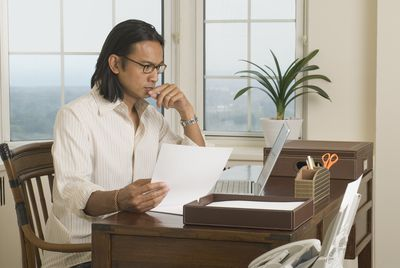 Man at desk in home office