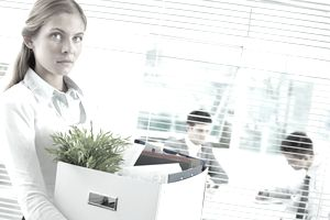 Woman removes personal effects from her office