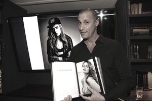 Nigel Barker posing with his book