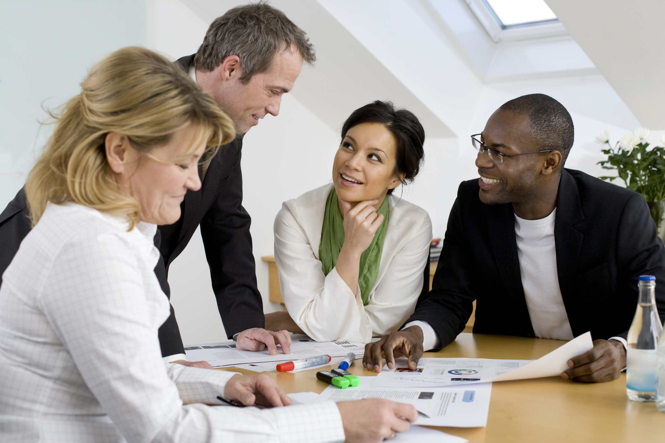 Employees meeting in a typical workplace and these employees are empowered to make a difference.