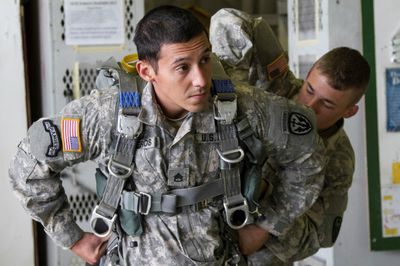 Soldier putting on gear