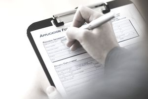 young woman filling application form