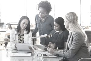 Four female employees assessing whether their employees are ready to commit to change.