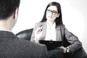a business woman meeting with a young person
