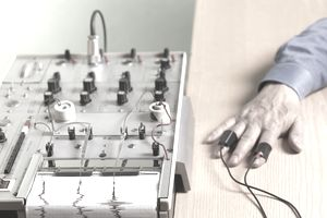 Man hooked up to lie detector test
