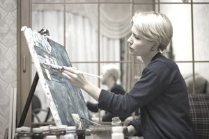 Young Woman Painting on an Easel