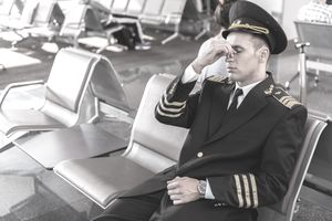 Exhausted airline pilot at terminal