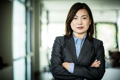 Businesswoman with arms folded looking at camera