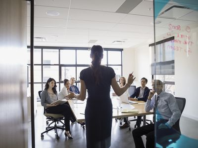 Businesswoman leading meeting in conference room