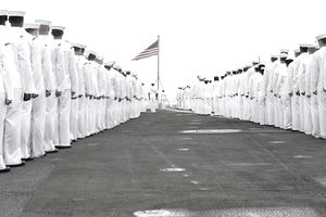 Sailors prepare to man the rails on the flight deck of the aircraft carrier USS Harry S. Truman.