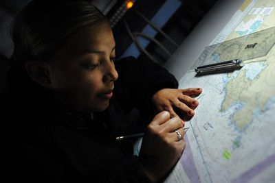 Operations specialist marks a map