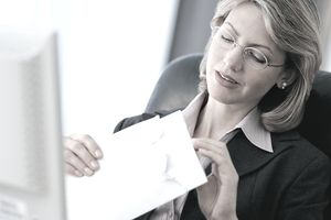 Woman opening envelope with letter