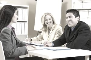 Two women and a man in a job interview