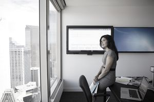 Woman thinking in conference room