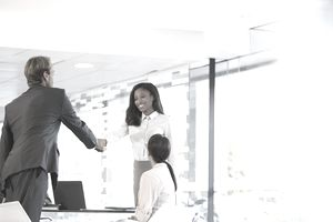 Business people shaking hands in an office building
