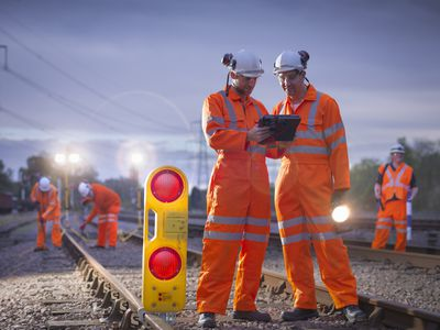 Crew of railroad workers working overtime into the night.