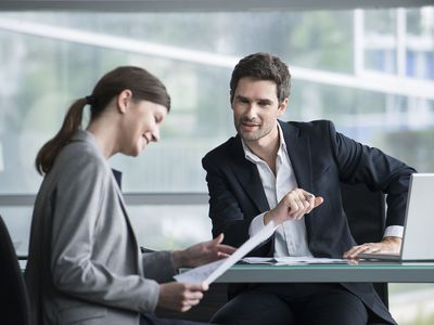 Smiling woman demonstrates her skill in planning during an interview.