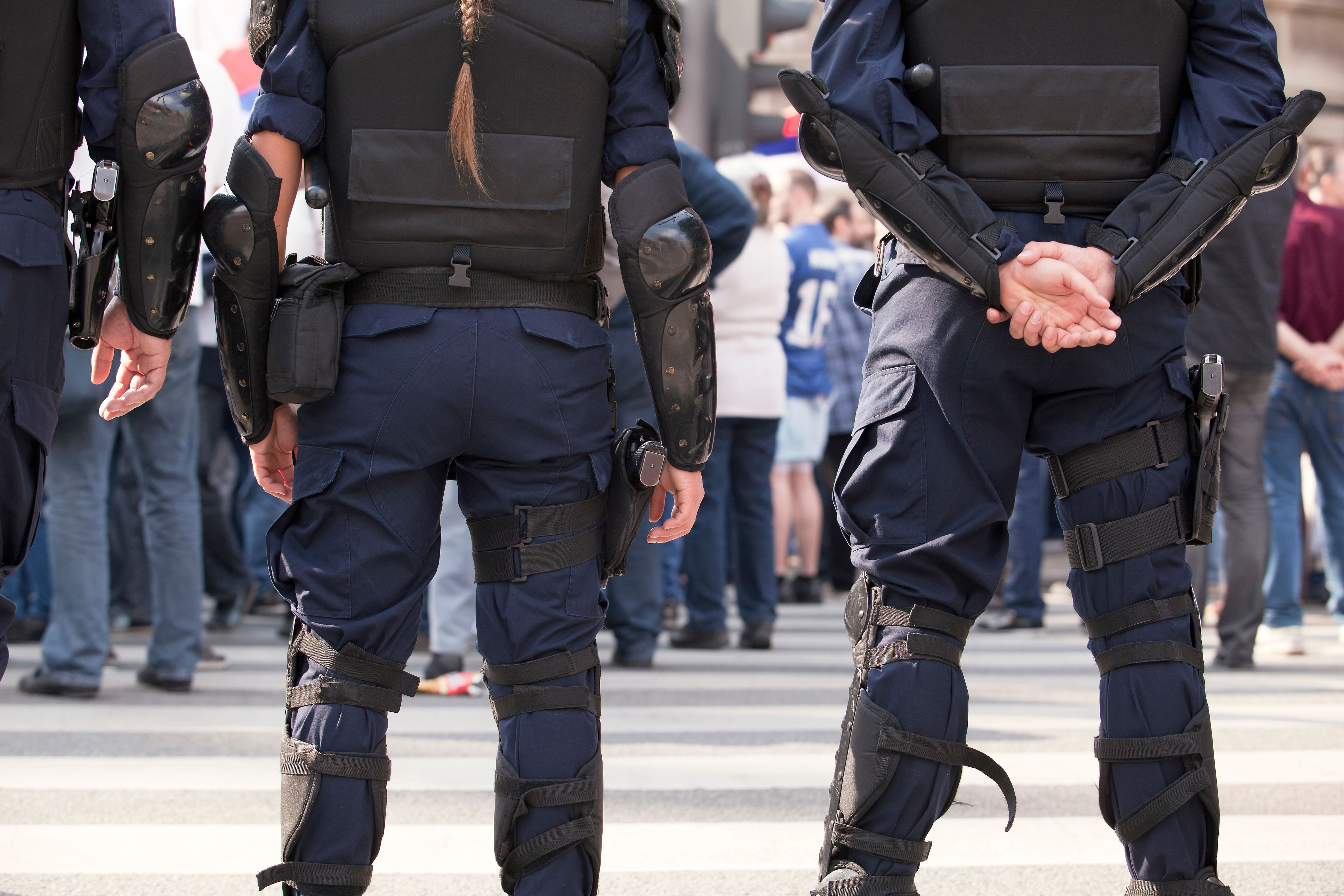 Midsection Of Police Officers