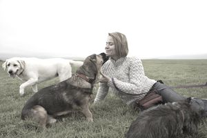 Woman with dogs in field