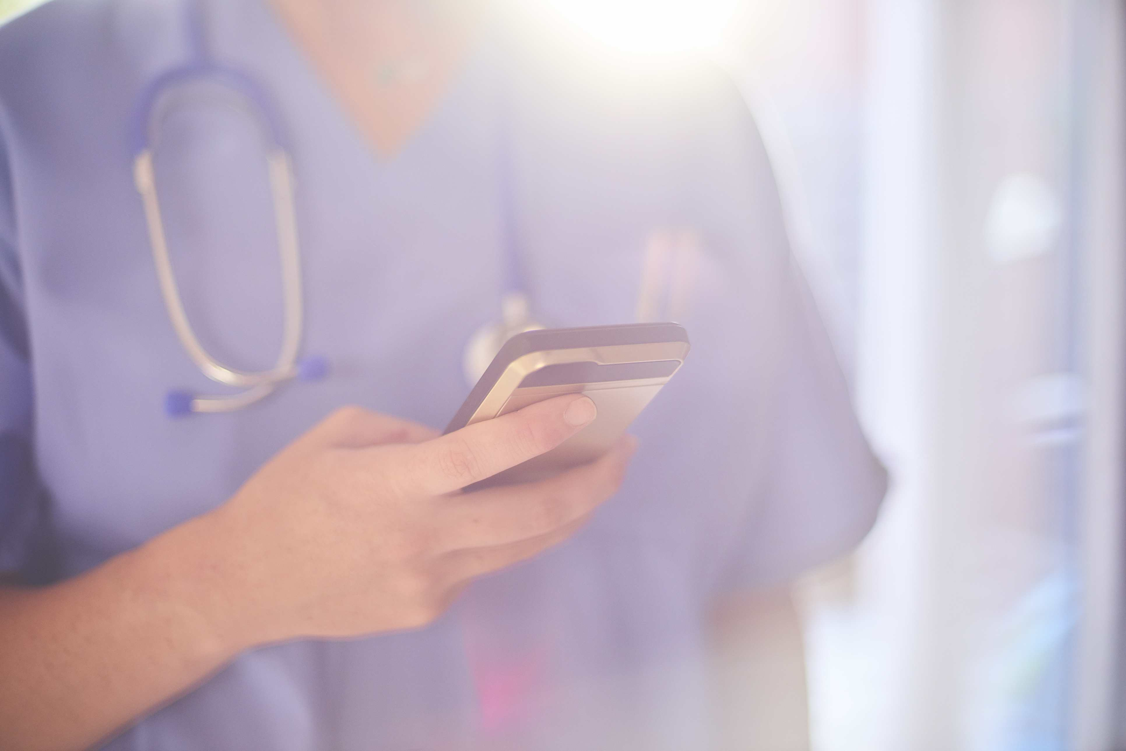 Nurse with mobile phone