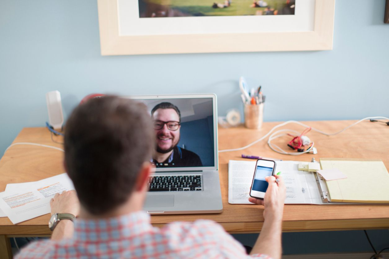 Two people on a telecommuting video call