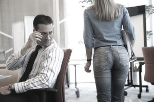 Businessman checking out female coworker.