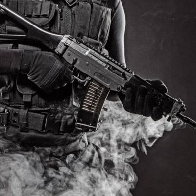 Military police officer holding an assault rifle