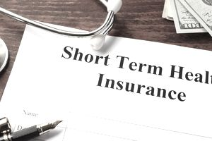 Short term health insurance policy on a table.