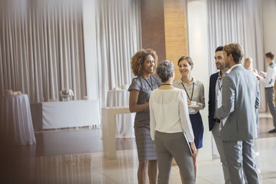 Group of people chatting at a professional networking event