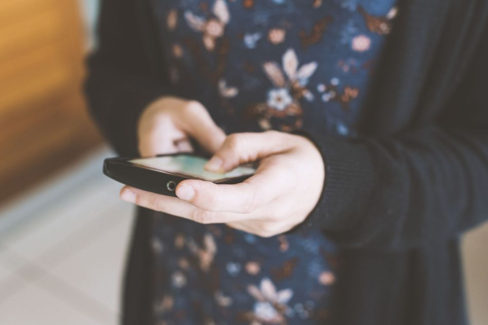 Person using smartphone to search a keyword.