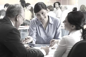 Woman smiling while talking with her managers.