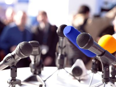 Close-Up Of Microphones On Table at a Media Event