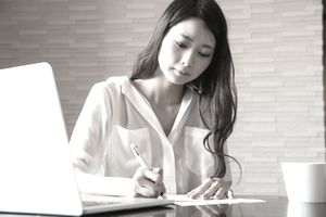 Woman preparing business correspondance