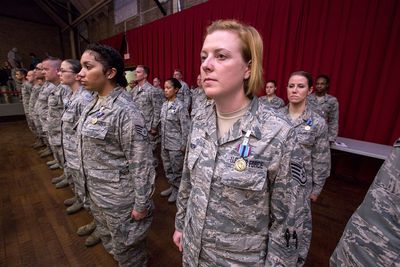 New Jersey Air National Guard Airmen stand at attention after receiving the Humanitarian Service Medal