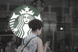 Woman entering a Starbucks