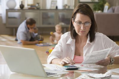 A picture of a mom paying the bills