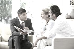 Salesman talking to a couple about a product