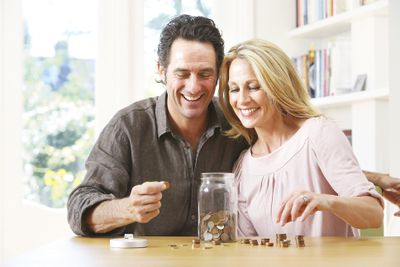 middle-aged couple counting coins