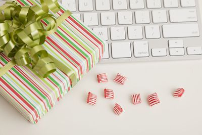 Holiday gift sitting on a keyboard, representing job searching during the holidays.