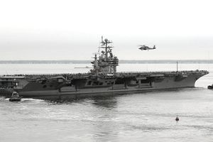 NORFOLK, VA - OCTOBER 13: In this U.S. Navy handout, the aircraft carrier USS Harry S. Truman departs Pier 14 at Norfolk Naval Station October 13, 2004 in Norfolk, Virginia. (Photo by Jason R. Zalasky/U.S. Navy via Getty Images