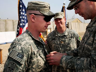 A soldier receiving a commendation
