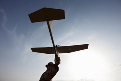 A soldier preparing to launch an Unmanned Aerial Vehicle