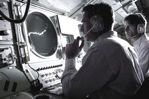 Male navigator on submarine radar