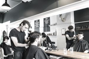 Hairdresser cutting customer's hair