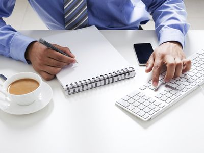 Man with notepad and computer